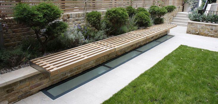 Walk on glass floorlight within garden to allow light into basement space