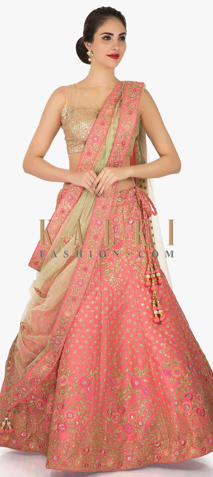 Buy Online from the link below. We ship worldwide (Free Shipping over US$100)  Click Anywhere to Tag Pink raw silk lehenga adorn in zari and resham embroidery work only on Kalki This pink lehenga is a pure outfit goal for the next shaadi you attend! The lehenga in featured in raw silk fabric. It is perfectly formed using the zari and resham embroidered work with sequin specification. It comes with an unstitched blouse in raw silk. The doll like hem of the lehenga elevates the look even more…