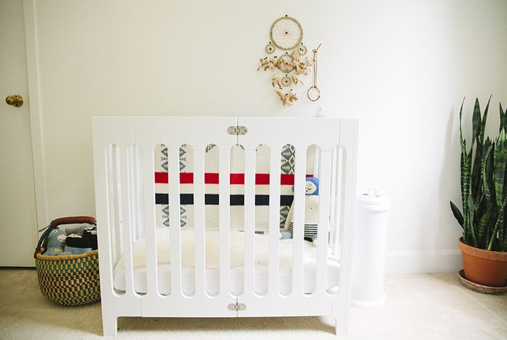 Former totStuff contributor @Melissa Squires Henson james's corner for little  Sailor includes the Bloom Alma mim-crib from and the ubbi diaper pail - both from #tottini!
