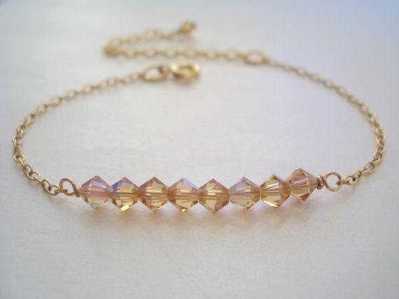Swarovski golden crystal slim bracelet with gold filled chain   This modern bracelet is made with golden Swarovski crystals and slim gold filled