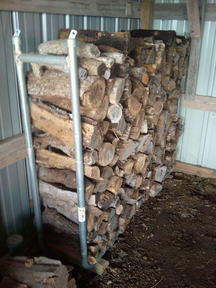 Firewood crib using damaged trampoline parts