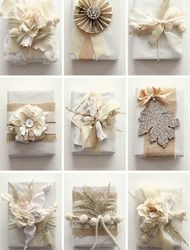 DIY Gift Wrap by Grey Likes Weddings  Read more - http://www.stylemepretty.com/living/2009/12/16/diy-gift-wrap-by-grey-likes-weddings/