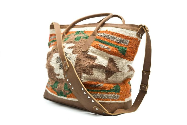 This weekender is handmade with authentique carpet textiles from Momostenango combined with genuine leather. This overnight bag is perfect for everyday use or a weekend getaway.