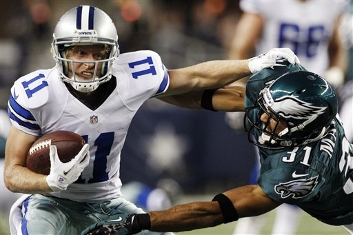 Dallas Cowboys wide receiver Cole Beasley (11) pushes off Philadelphia Eagles defensive back Curtis Marsh (31) during the first half of an NFL football game, Sunday, Dec. 2, 2012, in Arlington, Texas. (AP Photo/Tony Gutierrez)