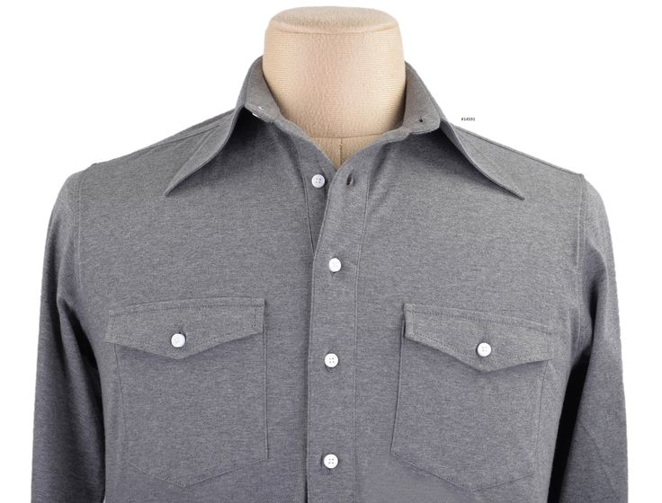Luxire casual wear constructed in Mid Grey Jersey: http://custom.luxire.com/products/tpr-mid-grey-jersey-tpr_mid_grey_jsy_25  Consists of spear point collar with 4″ collar points, chest pockets with flap and single button cuffs.