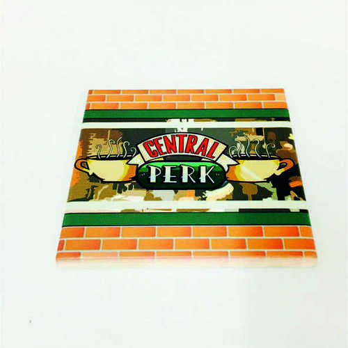 White Ceramic Tile Coaster, perfect for any fan of the hit TV show Friends – Featuring Central Perk Logo in Window.  Printed at Uveeka's HQ Full colour high quality printing Scratch Resistant, Shower Proof Size – 100 x 100mm High Quality Ceramic Used Gloss Finish