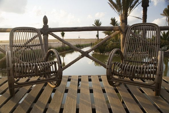 Brown Contemporary-Mediterranean Patio...A decked outdoor area with wooden rocking chairs.  check out the railing.....