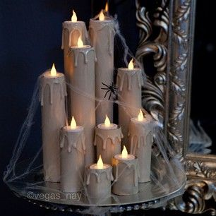 DIY Candles 1.) save toilet/towel paper rolls 2.) drip hot glue gun at top of rolls; let dry 3.) spray paint to desired color 4.) tape flameless tea lights on top end voilà