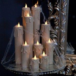 DIY Candles 1.) save toilet/towel paper rolls 2.) drip hot glue gun at top of…