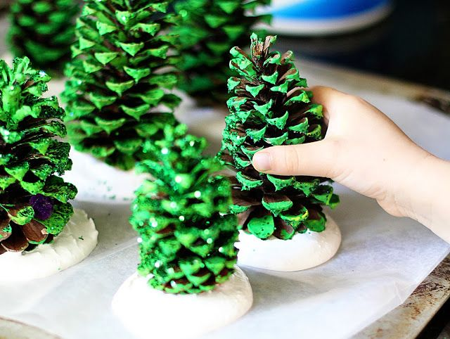 Pine cones painted green then add glitter, plop them on top of some plaster of paris or maybe salt dough, glue on beads. Little star on top would be nice.