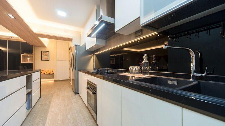 Kitchen Cabinets With Black Quartz Countertop And Black Tempered Glass Backsplash Modern