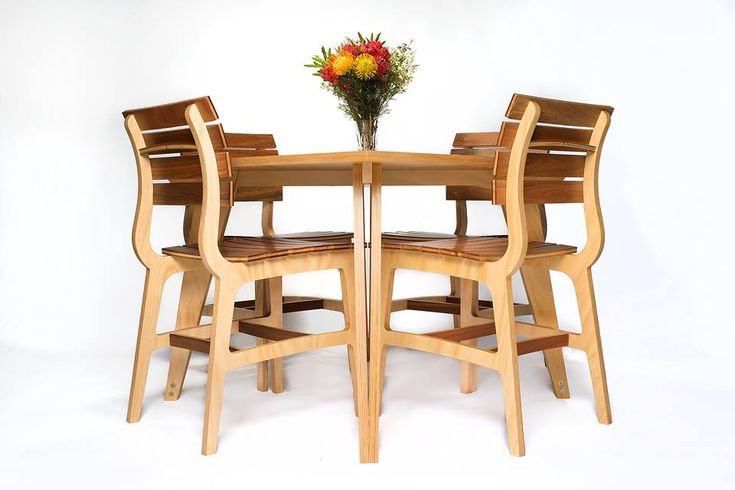 Dining table and chairs by eacdesign.com.au . hoop pine ply, radiate pine, spotted gum and brass