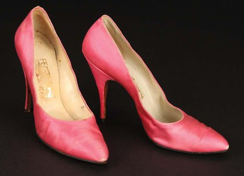 """The pair of pink satin stiletto-heeled shoes by Salvatore Ferragamo worn by Marilyn Monroe /Amanda Dell during the """"Incurably Romantic"""" song sequence in """"Let's Make Love""""."""