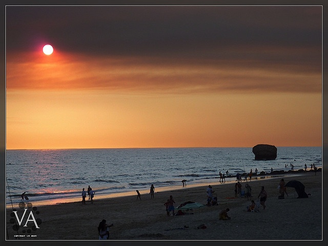 ■ Awesome sunset at Matalascañas Beach (Huelva, Andalusia, Spain), rendering people and features as backlit silhouettes against a darkened sun and Atlantic Ocean.    Taken handheld using a Panasonic Lumix TZ7 (ZS3) in available sunlight (110 mm, F5.6,  Visit, see, travel or tour in Spain. Wish you could go there too? imagine yourself making USD1000 a DAY! yes, per day! visiting these places are no longer a dream. click the picture, enter ur email address, and watch the video.