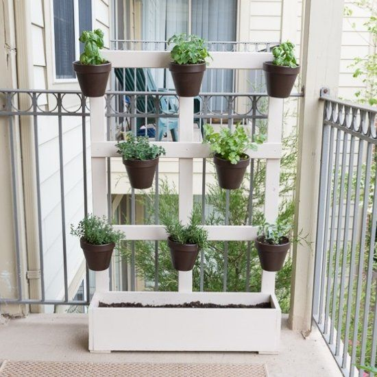 My lovely garden is made from scrap wood and really helps me maximize space on my balcony. It fits 8 herb pots and even a lettuce bed!