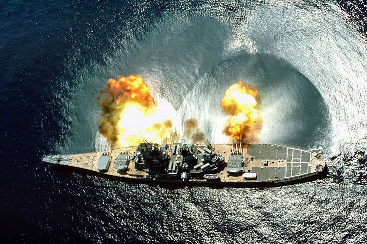 "USS Iowa (BB-61) fires a broadside of nine 16""/50 and six 5""/38 guns during an exercise."