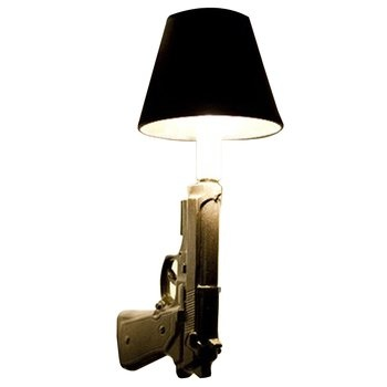 not sure how this would fit into my decor but my husband would sure like it...9mm Gun Sconces. The 9mm Glock pistol, a favorite of American law enforcement agencies, is transformed into a surreal take on the traditional wall sconce. $195.00