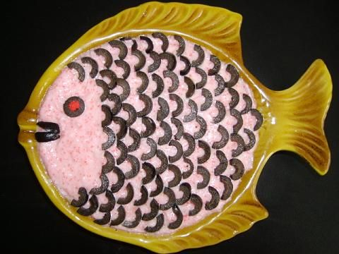 Roe Salad is a Romanian Fish Salad.  I don't know what it taste like but I love the decorative application of the black olives.
