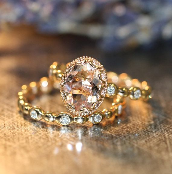 Stunning feminine and romantic! This wedding ring set showcases a morganite engagement ring with a 9x7mm oval shaped natural pink morganite crafted