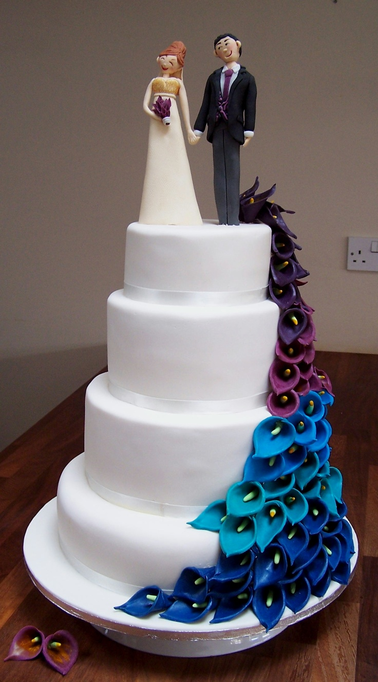 4 tier peacock inspired wedding cake with bride and groom fondant wedding topper