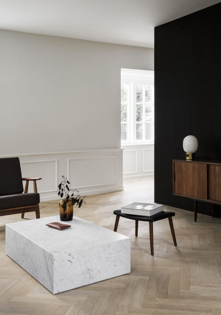 The Historic Villa Once Home to Poul Henningsen Receives a Modern Renovation - Photo 6 of 12 - The ground floor of the home was restored from its original configuration of small divided rooms into one spacious living area, and is now surrounded by windows on all sides.