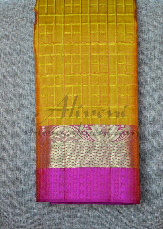 Mustardy Golden Yellow Kanchipuram Pattu Saree with Pink Borders