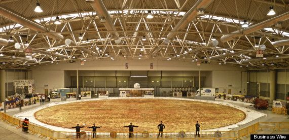 worlds largest pizza - The pie contained 19,800 pounds of flour, 10,000 pounds of tomato sauce, 8,800 pounds of mozzarella cheese. It weighed 51,257 pounds.