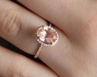 found it! rose gold ring with an oval peach saphire diamond fenced with tiny stones. i absolutely love it! perfection.
