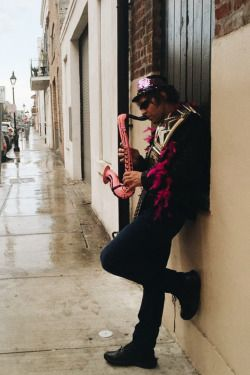"""Dean """"Jellyroll"""" Ambrose on the streets of New Orleans playing his little pink sax for the applause and adoration of his loving fans."""
