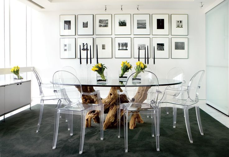 the space is a little cold, but i like the acrylic chairs with the dining table