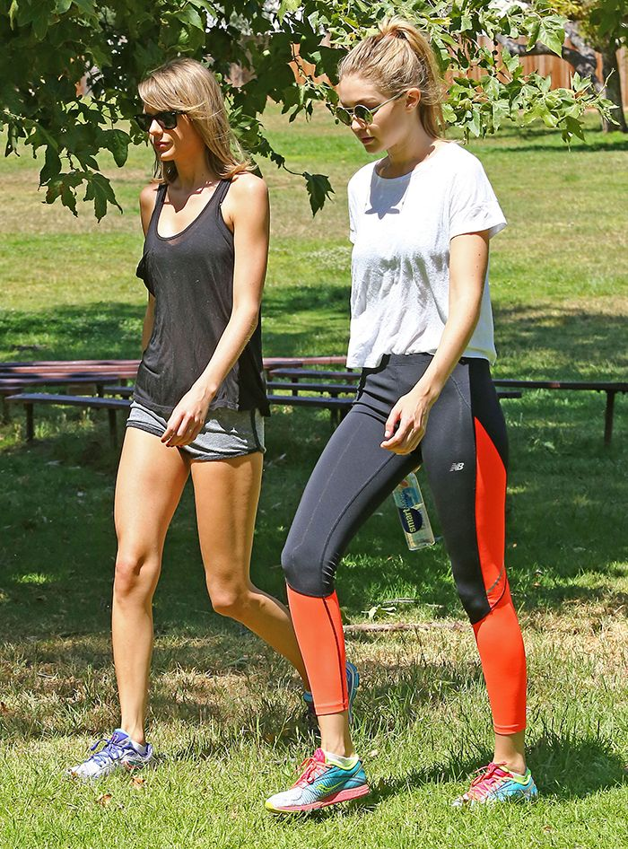 Gigi Hadid and Taylor Swift in workout clothing and sneakers