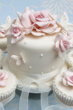 Victoria Style cake and cupcakes for tower design. A pretty pastel pink gift cake decorated with sugar roses and butterflies. complement your cake with some gorgeous cupcakes.