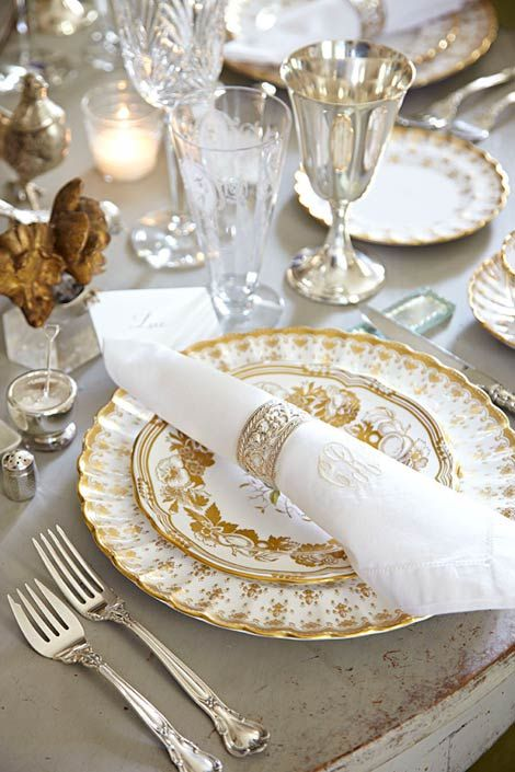 Chantilly silver, white and gold china on country table with silver goblets