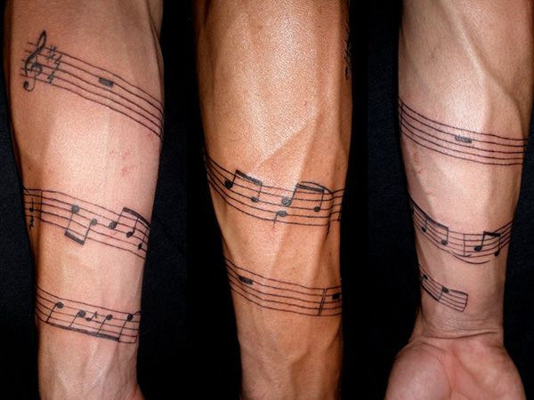 musical arm 26 Charming Music Tattoos For Guys