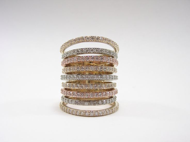 9 rows of heaven.  4.0 carat 9 row diamond band. 14 karat yellow rose and white gold #abrahamsjewellery