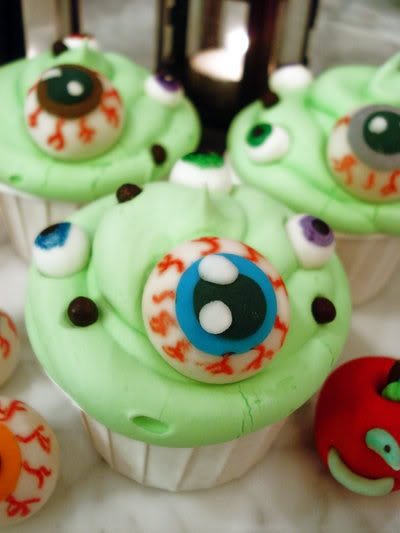 cupcakes w green toxic waste frosting eyeball sprinkles - Halloween Decorated Cupcakes