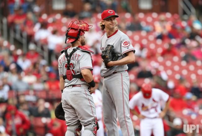 Cincinnati Reds catcher Tucker Barnhart talks with starting pitcher Bronson Arroyo in the fifth inning after giving up three runs to the…