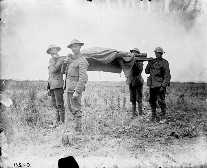 Canadian stretcher bearers carry the dead from a battlefield during the Battle of the Somme.