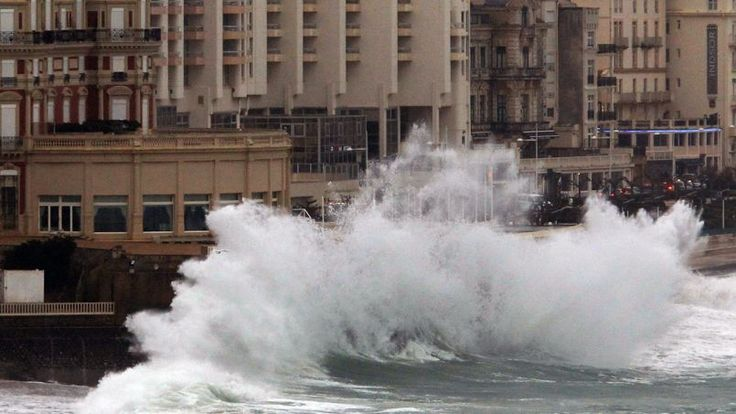 "In Biarritz, waves crashing against the Hotel du Palais on February 20.  In this city, a so-called ""crisis"" has been set up, with sand berms being constructed, especially on the Great Beach.  A sandbag wall was also installed to protect the municipal casino whose ground floor was flooded last year. All but two of France's Atlantic coastal departments and tidal river zones under alert from flooding, due to highest tides of year and storm surges."