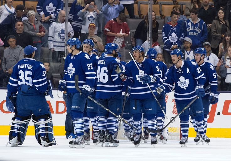 CrowdCam Hot Shot: Toronto Maple Leafs left wing Josh Leivo celebrates the win with Toronto Maple Leafs left wing David Broll in a game at the Air Canada Centre. The Toronto Maple Leafs won 3-1. Photo by Nick Turchiaro