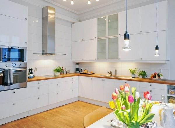 white cabinets with brown table tops and really nice wooden floor
