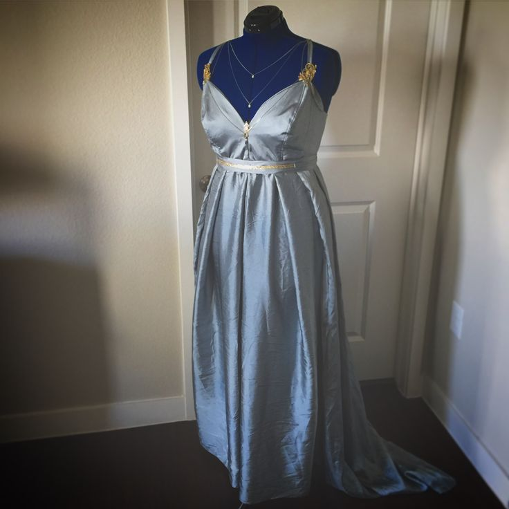 Blue satin fantasy gown embellished with repurposed jewelry. August 2017