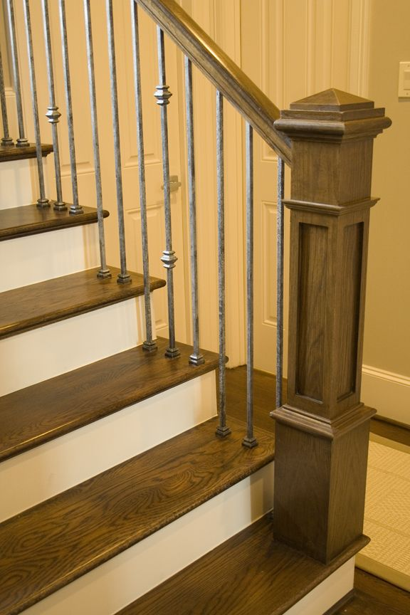 This staircase uses high quality wrought iron balusters to create a unique craftsman style design. Featured is the double knuckle baluster (16.1.35), the single knuckle baluster (16.1.34) and the plain square bar (16.2.1). These balusters are stocked in hollow or solid iron, and are available in a variety of finishes. These balusters are paired with industry standard wood components. We supply a variety of stock parts, custom material, and exotic wood. Click the image for more information.