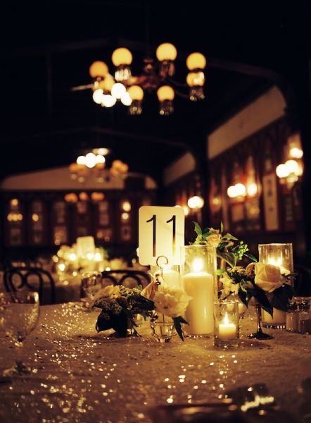We love using candles and glitter for a glamorous wedding! #blacktieweddings