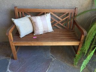 WOODEN BENCH WITH ACCENT PILLOWS. 37H X 52W X 26D