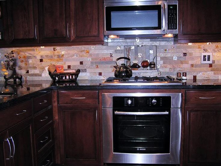 I love the look of those niches behind the range/oven. We are also planning an OTR microwave (please don't try to talk me out of that, my mind is set and it is what I currently have and am very happy). All the pics I see of range niches have hoods above them, not microwaves. Has anyone seen a range ...
