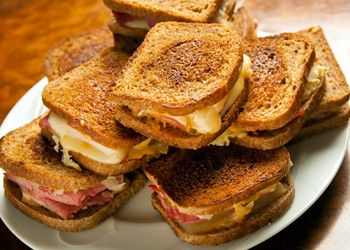Mini Reubens! Who says these can't be served on Saint Patrick's Day? The ultimate pub food- these delicious sandwiches are made with corned beef and sauerkraut (cabbage)!