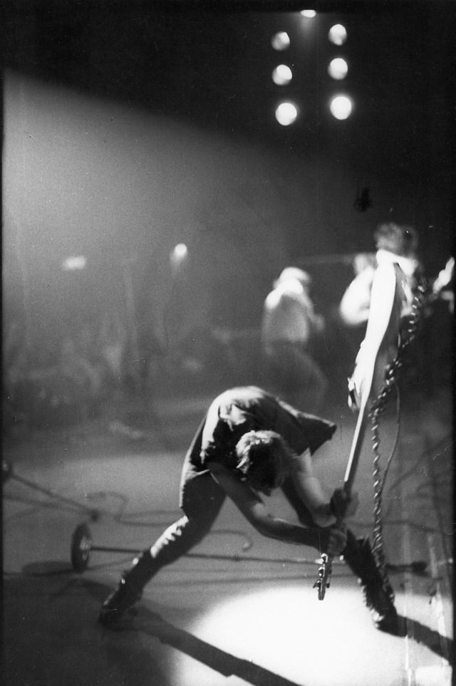 The Clash's Paul Simonon smashing his guitar by Pennie Smith