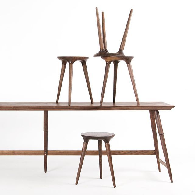 Four Coventry Stools Stacked On A Custom Made Rockport Console Table All In  Walnut On A White Background By Studio DUNN.