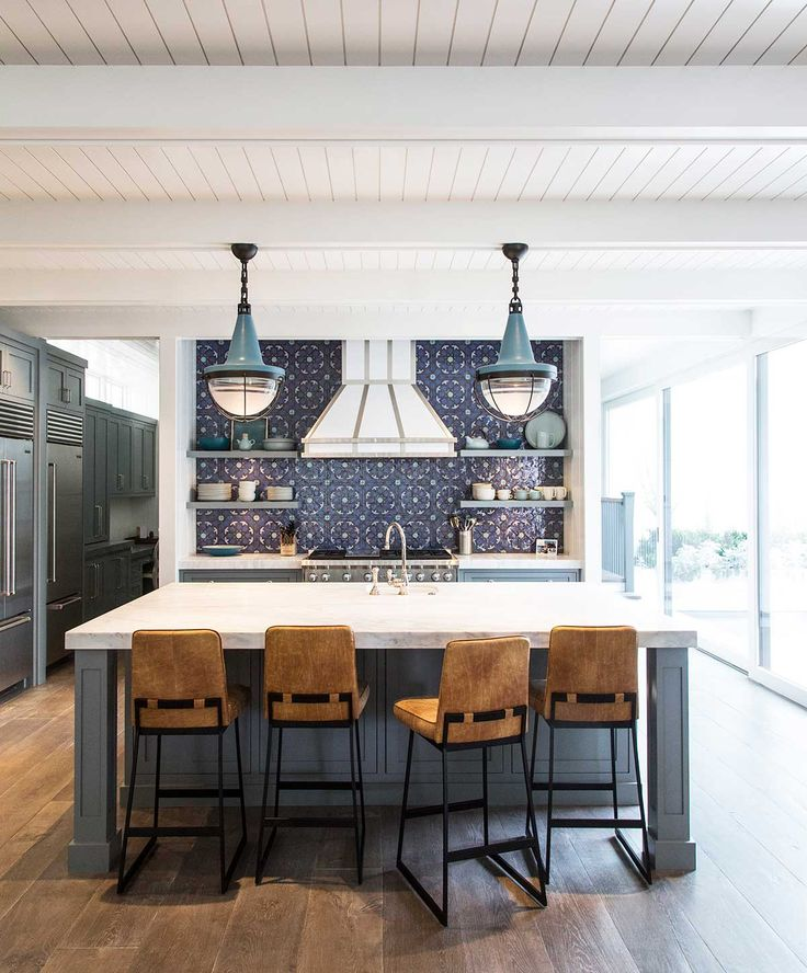 Blue patterned tile backsplash. Marble countertop. Check out this image from The Urban Electric Co.